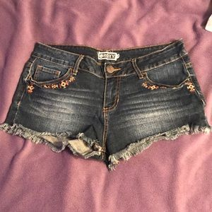 Roux jean shorts with tribal pocket detail